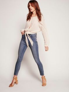 Extreme High Rise Skinny | High rise jeans featuring an ultra sleek, skinny silhouette and stretch fabrication for an easy wear. Five-pocket styling and zip fly with single button closure for an easy, effortless fit. Back pocket design makes for a flattering look.