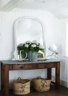 console table for entryway plus mirror and flowers