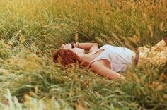 field, girl laying in a field of tall grass, countryside