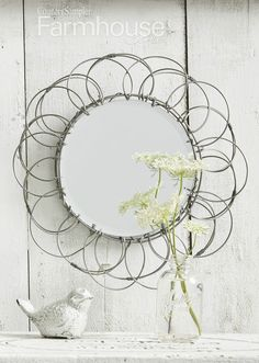 The shapely lines of a wire egg basket can become the backdrop for a small beveled-edge mirror. Just attach the mirror in place using a metal plate hanger. This project originally appeared in the Winter 2018 issue of Country Sampler's Farmhouse Style. Wire Egg Basket, Beveled Edge Mirror, Country Wall Decor, Country Sampler, Plate Hangers, Farmhouse Style, Backdrops, Diy Projects, Diy Crafts