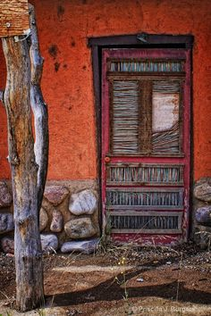 Description: One of several such doors in Mora, New Mexico
