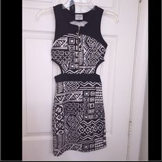Tribal black & white party mini dress Very pretty mini dress for a night time party occasion. Zip up in front with cut sides. Offers are accepted PacSun Dresses Mini