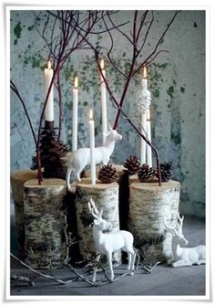 winter decorations - love the white deer. You could do this with pieces of your Christmas tree trunk.