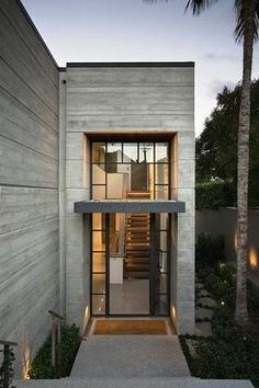 flat roof precast house modern structure ideas Love the full glass entrance against the precast walls