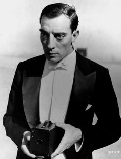 Film comedian Buster Keaton holding a box Brownie camera. Get premium, high resolution news photos at Getty Images