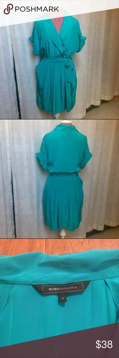BCBG teal shirt dress 12 BCBG teal shirt dress with tie waist. Gorgeous color and material. Two pockets. Bought at BCBG Paris store and only worn once! Nearly perfect condition!! Beautiful dress! 12. BCBG Dresses