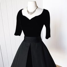 "1950s suzy perette new york black cocktail party dress    the suzy perette silhouette of cinched waist and full skirt were extremely popular in the early fifties and a quality interpretation of dior's famous ""new look."" sidney blauner, whose manhattan firm turned out the suzy perette label, acquired the right to incorporate dior's notions in their designs- and this dress is a fabulous example!    -classic silhouette with a fitted bodice and a full skirt    -ink black velvet compliments matte…"