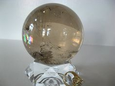 $500.00***A+  SMOKY QUARTZ SPHERE: Awesome, high-clarity sphere with gorgeous rainbow. Crystal Gifts, Smoky Quartz, Mineral, Snow Globes, Clarity, Art Pieces, Rainbow, Rock, Crystals
