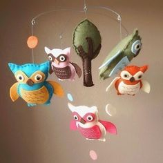 This pink blue and gender neutral green orange and brown baby owl mobile is precious here http://bit.ly/13w6Dy