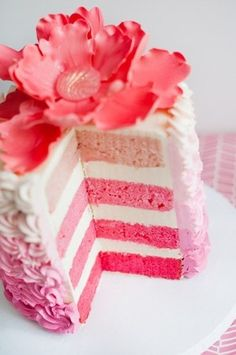 pink and white layer cake w/ pink flower on top