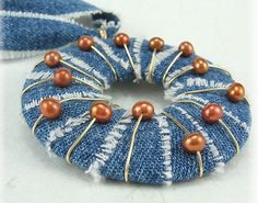 Pendant--made of denim strips wrapped around a washer? Would make a unique Christmas ornament, too.