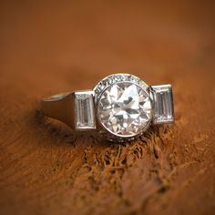 A lovely Art Deco Engagement Ring sold by Estate Diamond Jewelry