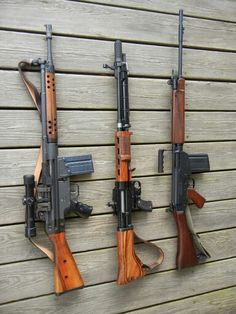 HK G3 scoped with CETME type wood furniture, reproduction FG42 German paratrooper rifle, & FN FAL with wood furniture.