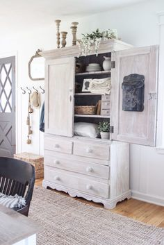 Armoire Makeover - Whitewashing Tutorial Step inside this beautiful Indiana farmhouse entryway decorated with a mix of timeworn antiques and unique DIY projects! Armoire Makeover, Furniture Makeover, Furniture Sets, Home Furniture, Furniture Design, Farmhouse Style Furniture, Country Furniture, Repurposed Furniture, Primitive Furniture