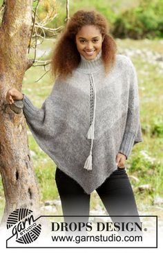 "Knitted poncho with stripes turtle neck in rib and twined string with tassels in ""Alpaca"" and ""Brush"