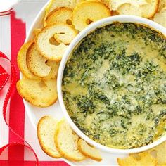 Baked Creamy Spinach Dip Recipe -I'm a fan of classic dishes but frequently tweak them a bit to suit my family's tastes. My cheesy spinach dip is a little lighter than other versions I've seen and pairs well with bagel chips. —Jenn Tidwell, Fair Oaks, California