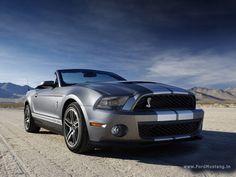 Drive along the California coast in a convertible Mustang.