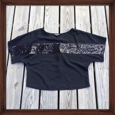 Express Sequin Top This wide neck Express blouse features a sequin embellished design that runs across the chest and onto each wide cut sleeve. NWOT Express Tops