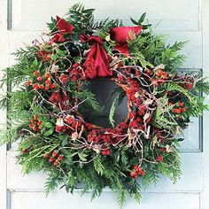 Cedar and Red: A fresh cedar wreath gets a shot of texture with branches and berries. Top it off with a length of wide red ribbon.