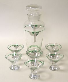 Doulton deco: Tango cocktail liqueur set, c1930s. Green colourway - abstract geometric design on glass with black and green highlights and green bands. Shaker has incorrect - though well-fitting - lid.
