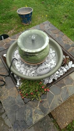 Bubble fountain for my patio. Repurposed fire pit, diy planter fountain and some rock garden plants surrounding.