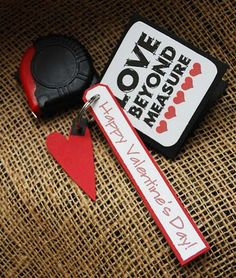 """maybe with a little strip of fabric measuring tape on a card with the words """"Love Beyond Measure"""" on it"""