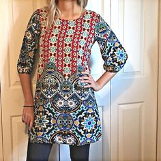 "Last1 MULTI PRINT TUNIC Absolutely beautiful tunic! Scoop neck with 3/4 billowy sleeves. The back of the tunic is hollowed out at the top for extra umph. Pffs pair this with leggings, jeggings, skinnies or skinny bells. Cute with boots or sandals. Look in my closet for jewelry ideas.▪️MED: B:18"" W:19.5"" H:21.5"". 100%Poly Tops Tunics"