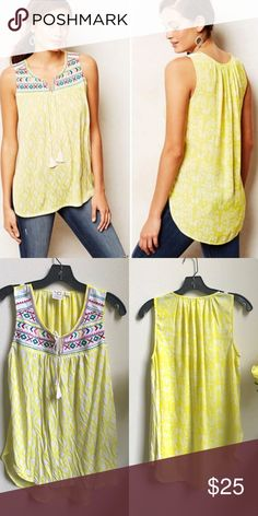 Anthropologie One September Tyndall Tank Anthropologie Tyndall Tank by One September Balancing innovative prints with vibrant color, one.september imbues their easy, go-to shapes with femme fabric manipulation, a vintage feel and a dose of sunny optimism❤️ By one.september Pullover styling Rayon, polyester, cotton Hand wash This tank is in excellent condition in the yellow motif.  A very vividly colored tank for a hot summer's day. Anthropologie Tops