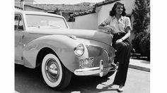 1941: American screen beauty Rita Hayworth (1918 - 1987) poses beside a Lincoln. (Photo via John Kobal Foundation/Getty Images)