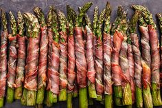 A simple appetizer recipe with thin slices of prosciutto wrapped around fresh asparagus spears and broiled until crispy.