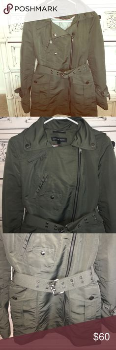 Andre Marc Olive/Army Green Rain Jacket A spring must have for those rainy days! This beautiful jacket has a unique side zipper, multiple storage pockets that add to its cool design, and a belted accessory to flatter those curves! It has very minimal signs of wear, such as light wear in the metal piece of the belt, and a small light stain that is almost unnoticeable bc of the fabric design. This is a very durable jacket that is almost impossible to get dirty! Andrew Marc Jackets & Coats