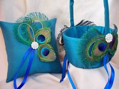 Peacock ringbearer pillow and flower girl basket.  Great ideas and not too hard for a DIY queen to do.
