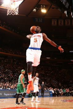 NEW YORK, NY - JANUARY 28: Tim Hardaway Jr. #5 of the New York Knicks goes for a dunk during a game against the Boston Celtics
