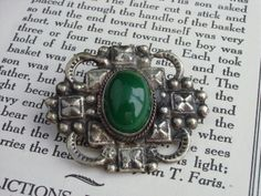 Impressive Arts  Crafts Sterling Silver Chrysoprase Brooch Pin Quality silver craftsmanship! Wonderful turn of the century brooch features a large green cabochon chrysoprase, bezel set in highly detailed sterling silver. Brooch is unmarked, but tests as sterling silver. C-clasp pin back, brooch is in very good antique condition, no dents or dings, secure clasp, warm patina. Circa: 1910 Measurements: 1.5 inch long, 2 inches wide. Weighs 17 grams.