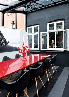 Laquered Red Table and contemporary black chairs
