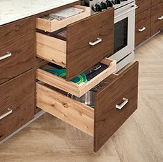 KraftMaid Deep Drawer Combination - Storage for the largest pan or the smallest rag: items of all sizes coexist peacefully in this multipurpose drawer. Kraftmaid, Drawers, Kitchen Innovation, Remodel, Cabinet, Kitchen Interior Design Modern, Kitchen Remodel, Accessories Storage, Storage