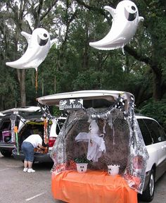 Trunk Or Treat idea - LOVE the use of the big ghost balloons as they float above the trunk.  Another plus - this isn't scary (which is important for our church's trunk or treat event).  LOVE!