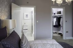 An en suite, walk-in wardrobe and a chandelier. That's how you do a master…