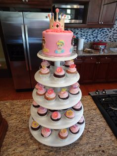 Tower of cupcakes with a cake on top
