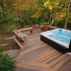 this curved deck is tucked into the woods for lots of privacy it feature a