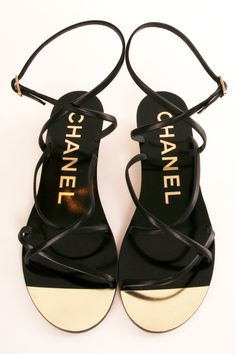 I see these in my dream....Chanel black strappy wedge sandals- gold buckle, gold toe section.