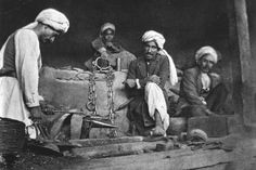 Blacksmiths at work in the Kabul bazaar in 1915-16. Afganistan.