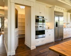 Pantry behind appliances.