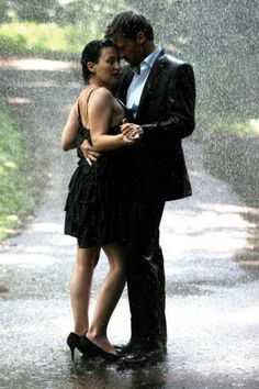 Dancing in the Rain. :) WISH someone would hold me and look at me like that when they danced with me rain or no rain!
