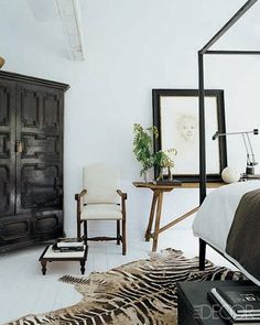 Gorgeous bedroom - black and white with a hint of the exotic in the vintage zebra hide