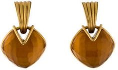10K yellow gold-plated brass Vaubel orange glass drop earrings with clip-on closures.