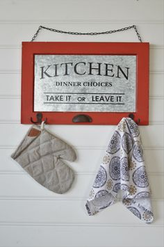 """""""Take it or leave it!"""" Mom's favorite saying in the kitchen and now all patrons can read it for themselves. We've displayed this quote on our version of a vintage window pane with a metal center, hooks for display, cup drawer pull detail and a metal chain ready to hang!"""