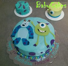 Monster Inc. themed 1st birthday cake with coordinating smash cakes for twins.