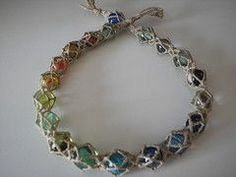 this is an AMAZING hemp bracelet!!! encasing the rainbow beads INSIDE a special wrapping of the hemp...I need to learn to do this!!!