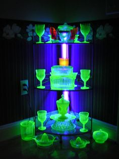 Just some Uranium glass in UV light.  Drink anyone? [Read more about uranium glass and all the various types of it here: http://en.wikipedia.org/wiki/Uranium_glass]